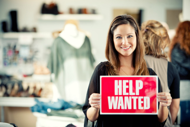 Boutique: Owner with Help Wanted Sign