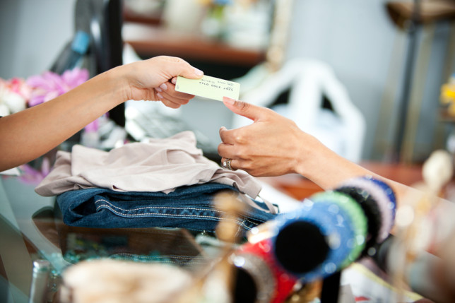 Boutique: Handing Credit Card to Saleswoman