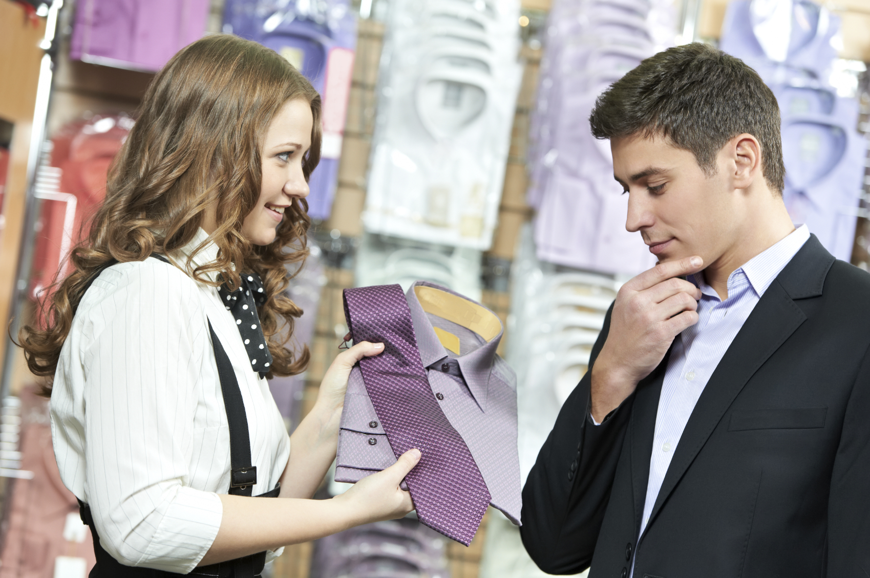 Elegant Young Man Choosing Shirt And Necktie During Apparel Shopping At Clothing  Store  Sales Associate