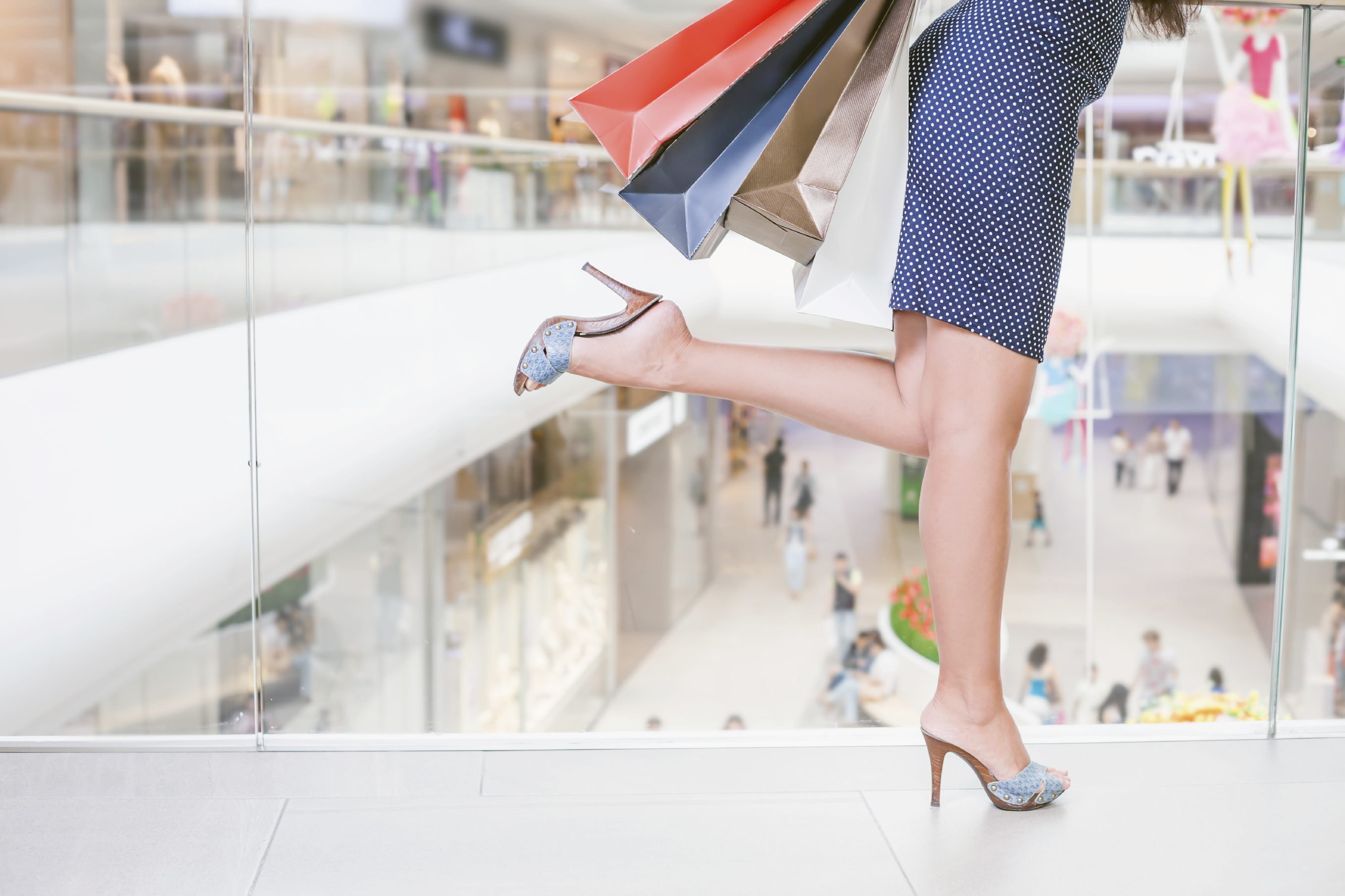 Closeup fashion woman s legs runs or rush for shopping discounts and sales  at the big mall 5568d4b872a