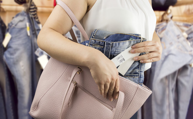 woman steals trousers at the boutique