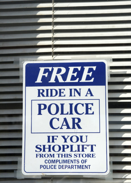 humorous warning to shoplifters posted in a store window